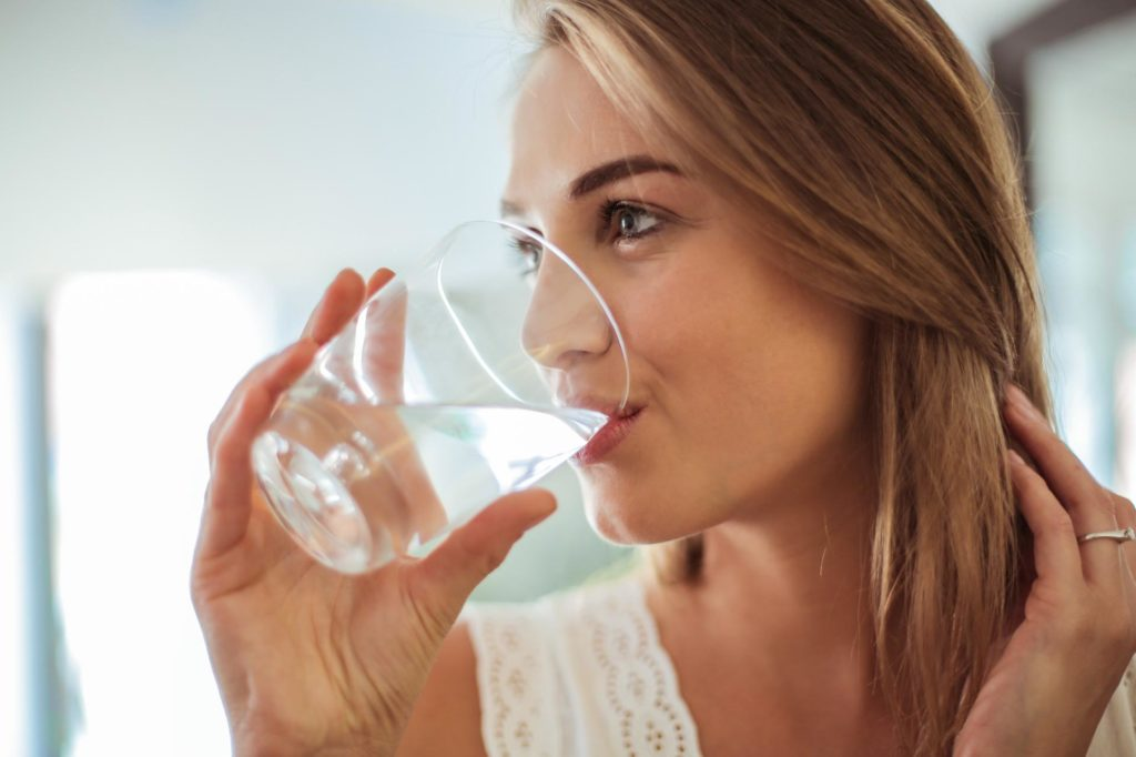 woman healthy drinking water