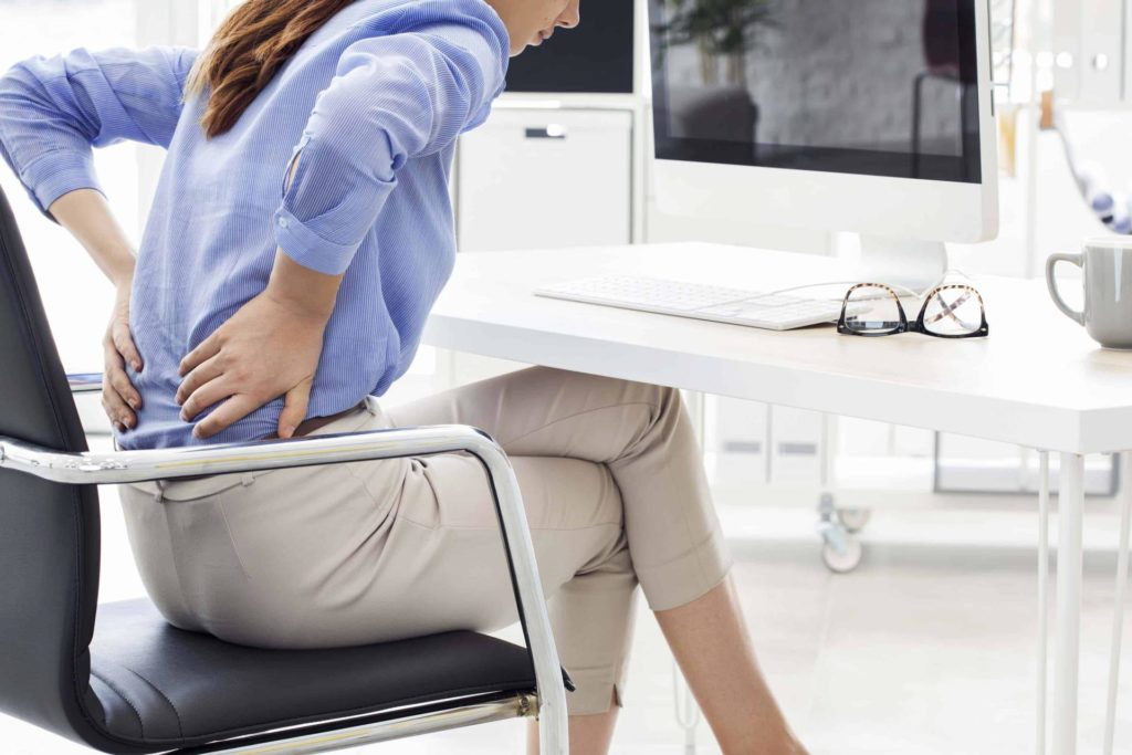 lady has a back pain sitting