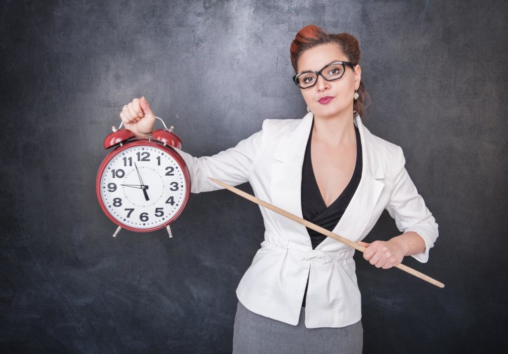 lady holding a clock and pointer