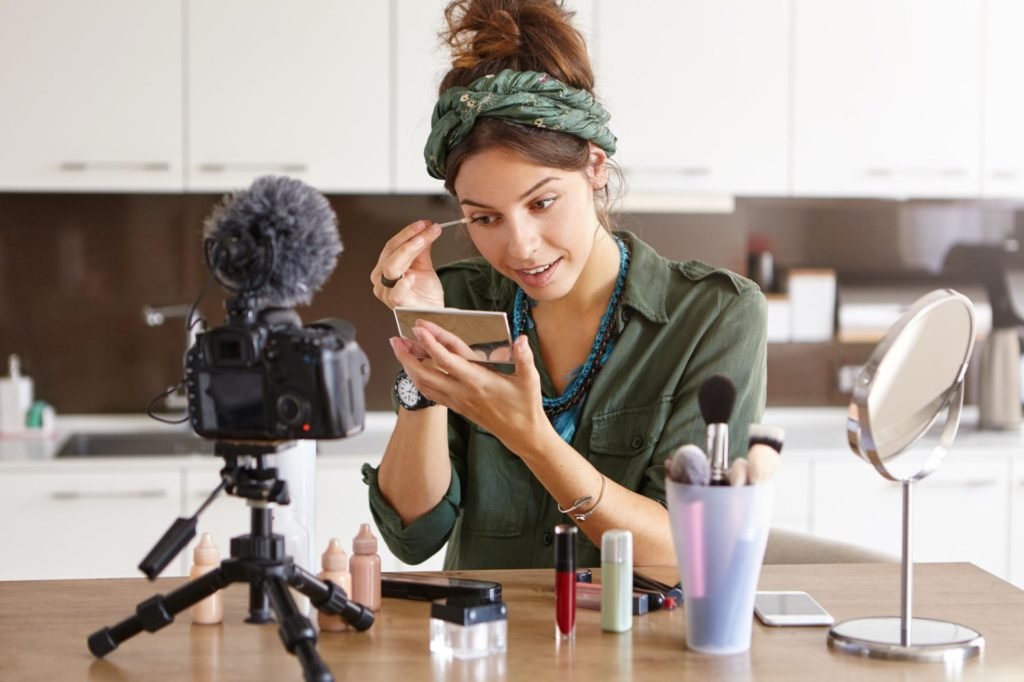 girl vlogger is shooting a make up tutorial