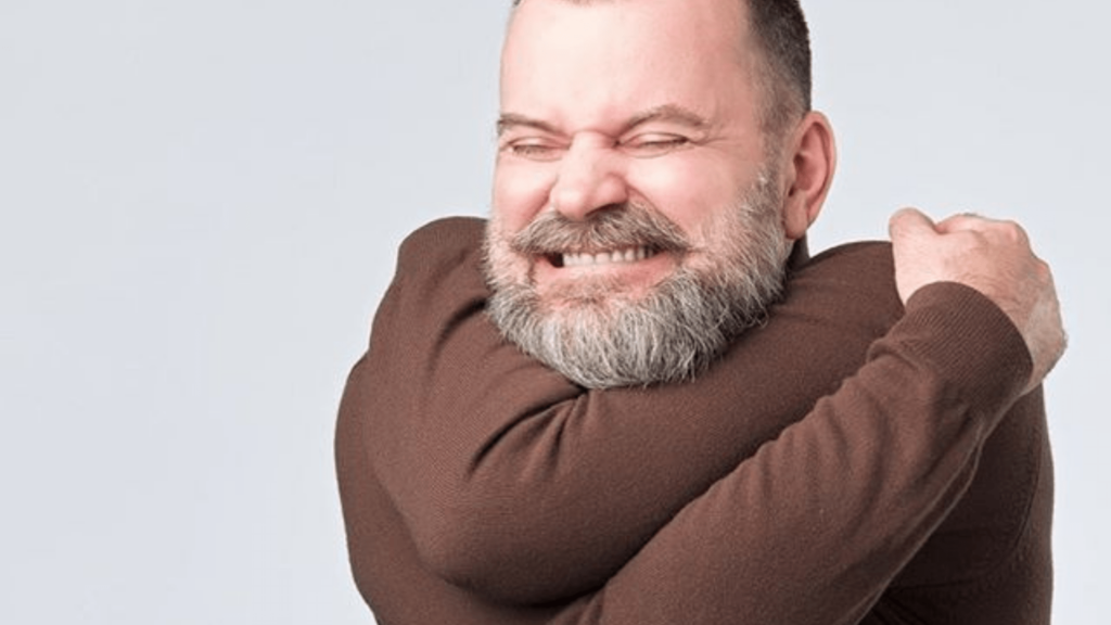 man hugging himself