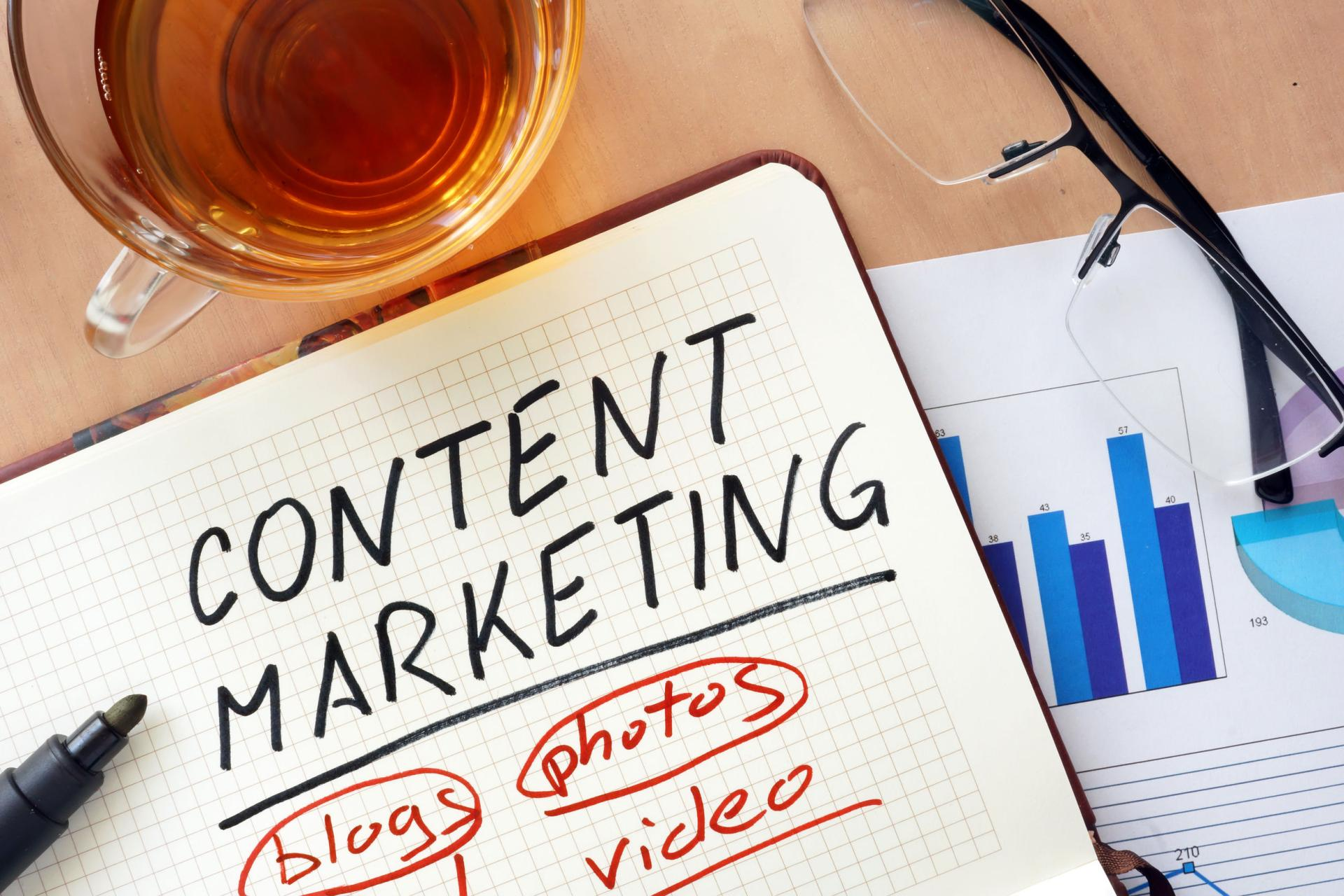 content marketing in a notebook with blogs photos and video written on it that represents how not to create mistakes in content marketing